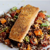 image of final product for cooking class - salmon on top of quinoa